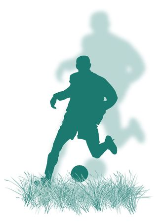 Soccer player silhouette playing soccer on the grass Stock Photo
