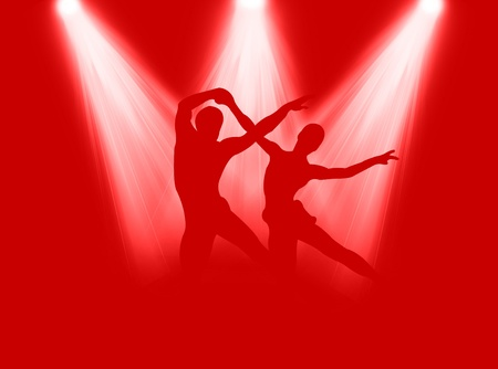 elasticity: Couple dancing in the bright spotlight on the stage