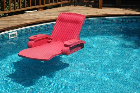 chaise lounge: Floating water chaise lounge Stock Photo