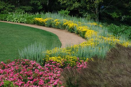 Curved path in tranquil garden Stock Photo