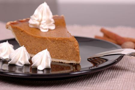 piped: Pumpkin pie with whipped cream Stock Photo