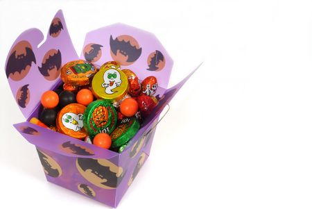 Colorful halloween candy in purple chinese container