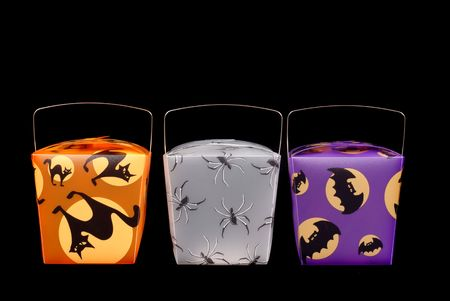 Colorful halloween candy carriers on black photo