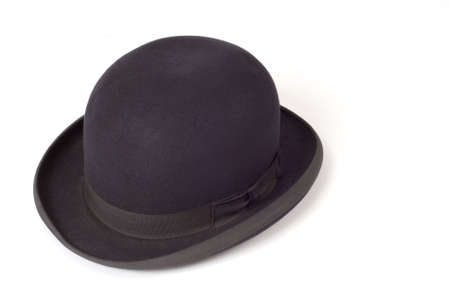 Old black derby hat isolated on white