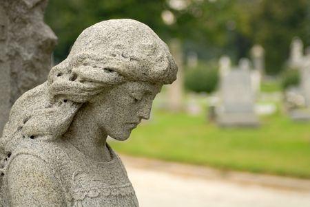 gravesite: Granite statue of angelic woman at gravesite
