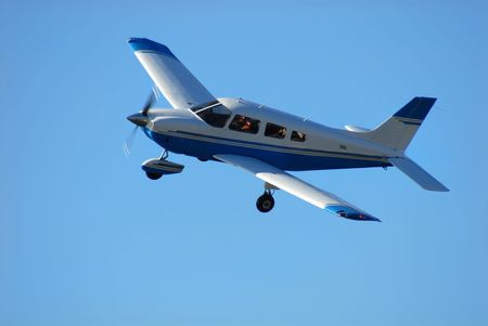 exhilarating: Single engine airplane in flight against a clear blue sky