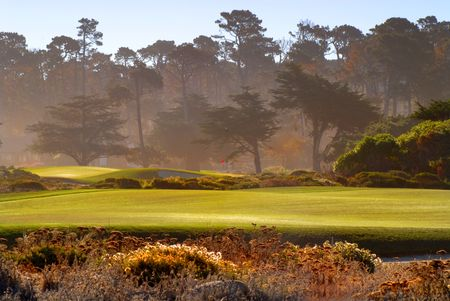 Fairway view of golf course in Pebble Beach California bathed in sunlight photo