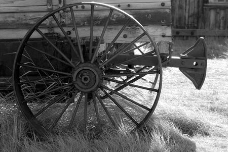 old wood farm wagon: Black and White image of an old weathered wagon with rusted wheel in rural setting