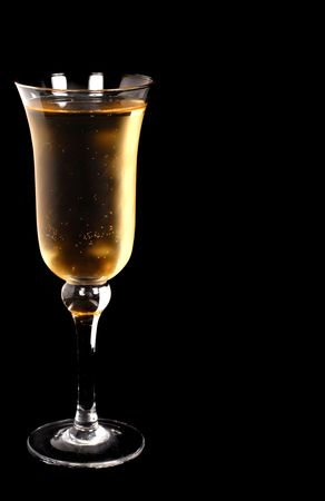 Refreshing champagne in a crystal glass on a black background Stock Photo