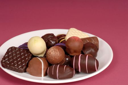 semisweet: A plate of delicious dark and semi-sweet chocolates Stock Photo