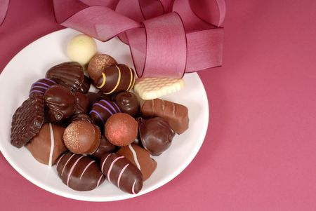 semisweet: A plate of delicious dark and semi-sweet chocolates with pink ribbon