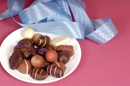 semisweet: A plate of delicious dark and semi-sweet chocolates with blue ribbon Stock Photo