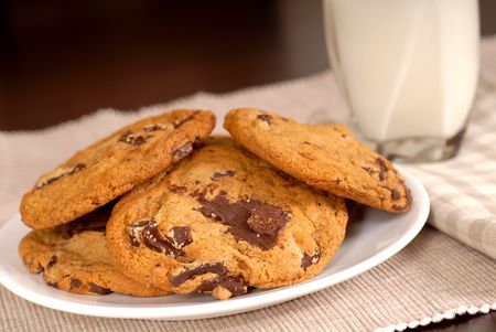 semisweet: Delicious chocolate chunk cookies with a glass of milk