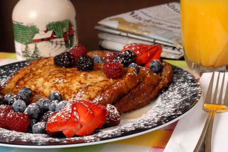 A plate of french toast with fruit and maple syrup Stock Photo