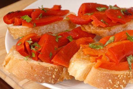 A plate of roasted red pepper and basil bruschetta Stock Photo