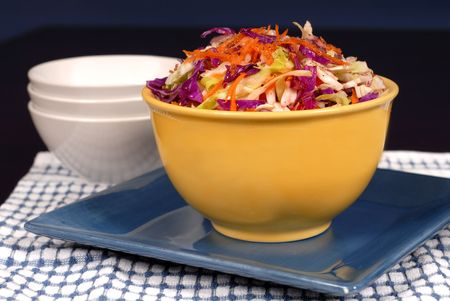 cole: Crisp cole slaw with carrot in a yellow bowl