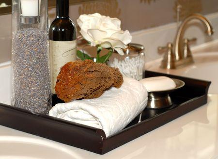 Towels, soap, sponges and bathoil on bethroom vanity Stock Photo - 869144