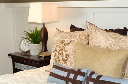 nightstand: A bedroom scene with bed and nightstand