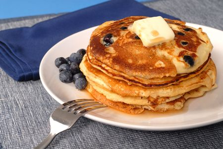 A stack of blueberry pancakes with maple syrup Stock Photo