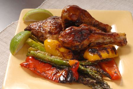 A plate of BBQ chicken and vegetables Stock Photo