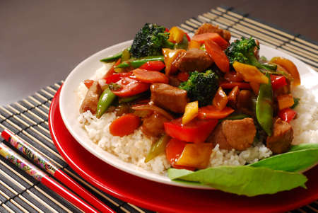 oriental food: A plate of pork stir fry with vegetables