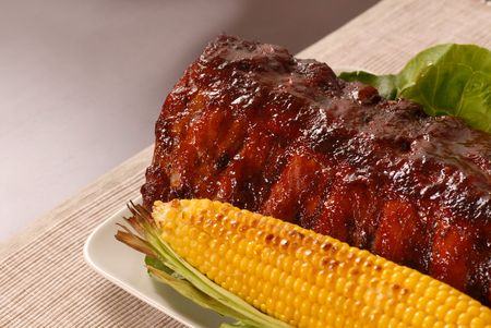 Slab of ribs with ear of roasted corn Stock Photo