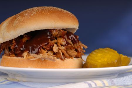 Pulled pork sandwich with pickles photo