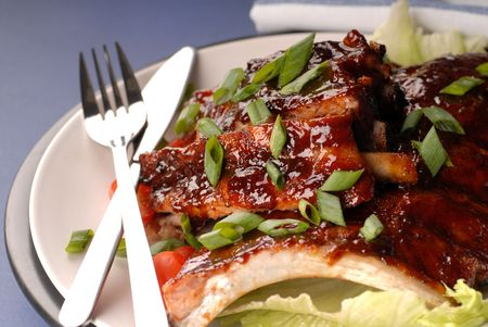 scallions: A slab of BBQ ribs with scallions