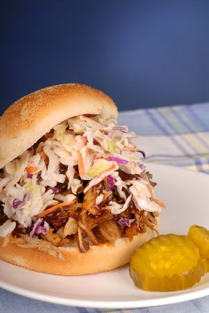 cole: A pulled pork sandwich with cole slaw and pickle