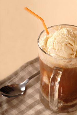 Close up of a root bear float with a spoon