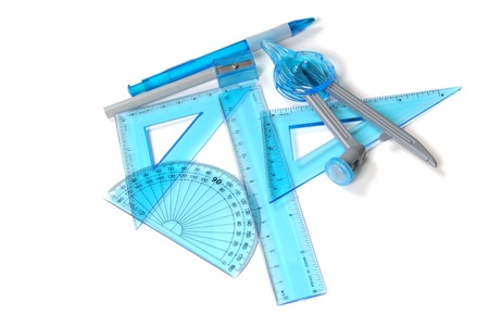 School supples including rulers, triangles, protractor, pencil and pencil sharpener