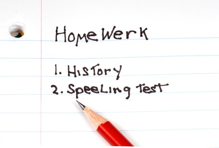 A list of homework to do with misspelled words Stock Photo