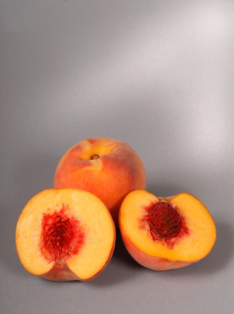 two and a half: Two ripe peaches, one cut in half