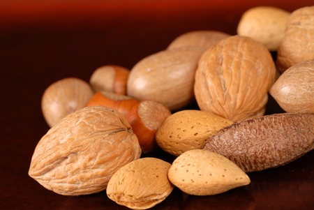 whole pecans: An assortment of fresh whole nuts on a table
