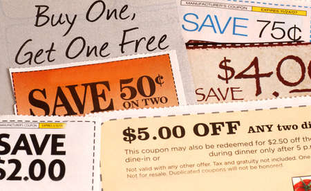 Variety of clipped store advertisement coupons on display