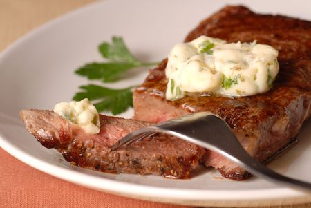 A grilled ribeye steak with a bernaise butter