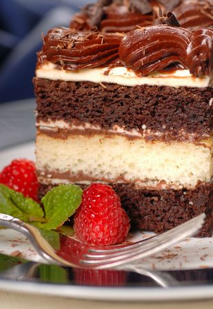 semisweet: A piece of chocolate layer cake with raspberries, mint and fudge frosting Stock Photo