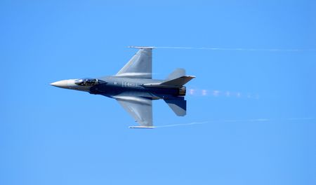 A Navy F-14 reaching supersonic speed against a pure blue sky Stock Photo - 2332027