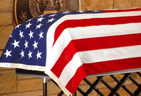 The coffin of a veteran draped with the American Flag Stock Photo