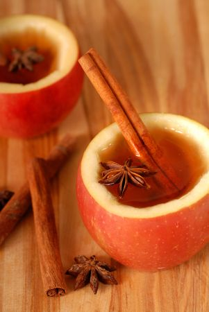 mulled: Spiced apple cider in hollowed out apples with cinammon and star anise Stock Photo