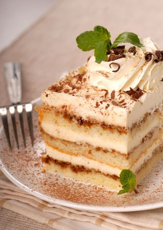 Creamy Tiramisu with cocoa powder and mint Stock Photo