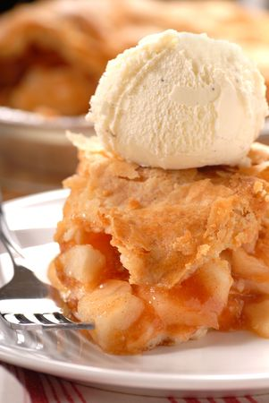 Deep dish apple pie with a flaky crust and vanilla ice cream