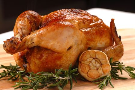Fresh roasted chicken with garlic and rosemary Stock Photo