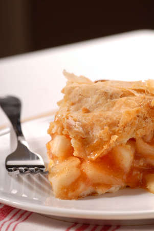 Slice of a freshly made deep dish apple pie