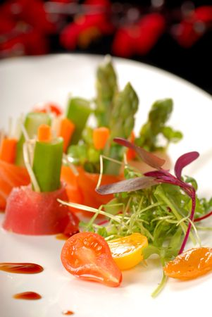 Plate of japanese sashimi with a micro green salad photo