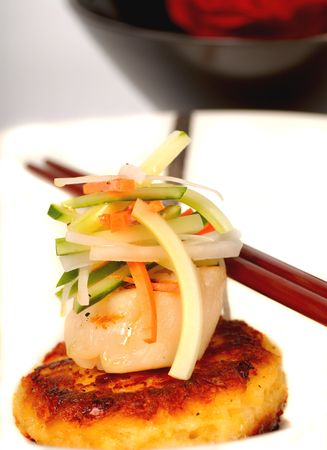 Asian scallop and crab cake appetizer with vegetables