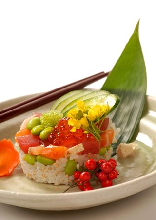 Beautiful Japanese appetizer of rice and tuna mold with vegetables  photo