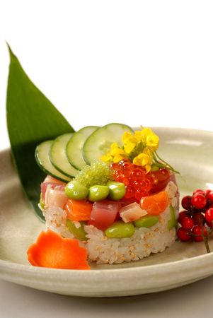 Delicious Japanese appetizer of rice and tuna mold with vegetables  photo