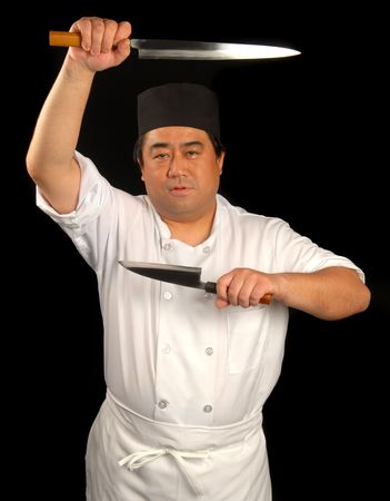 Asian sushi chef posing with his knives
