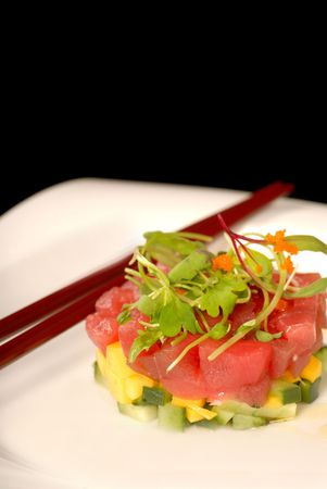 person appetizer: Asian seafood and mango appetizer with micro green salad